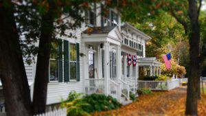Image of a house in autumn representing moving in the fall